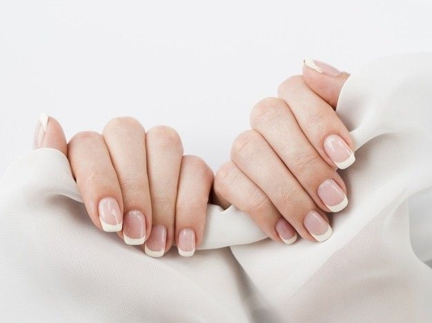 manicured hands holding soft fabric 23 2148226392