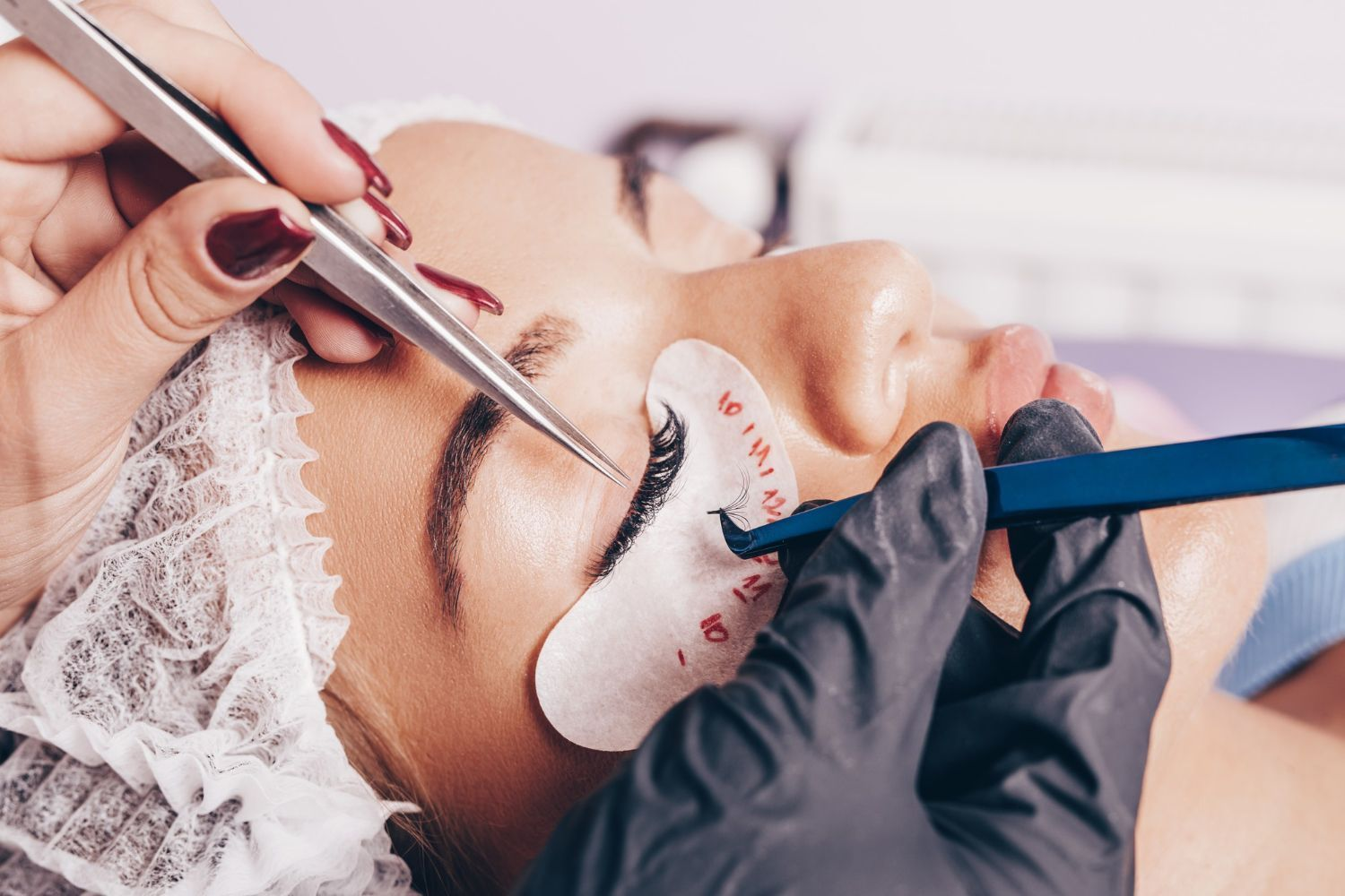 beautiful young woman at eyelash extension procedure cosmetics and body care close up shot 1